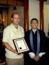 Jeffrey Ignarro receives certificate from Rev. John Iwohara